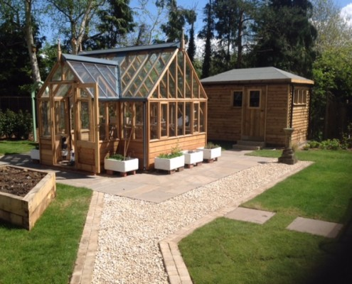 Bespoke shed and greenhouse quintessential garden must haves